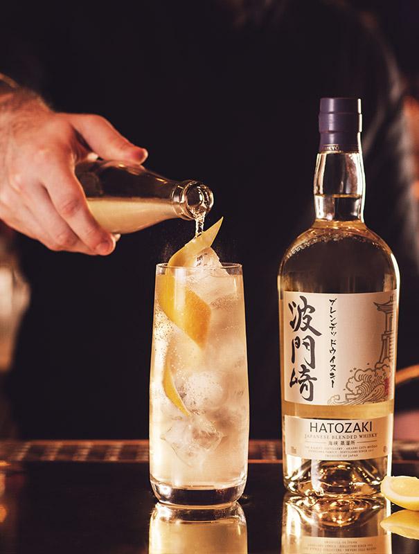 Barman pouring a Hatozaki whisky